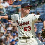 Atlanta Braves' Lucas Harrell pitches against the Miami Marlins during the first inning of a baseball game, Saturday, July 2, 2016, in Atlanta.