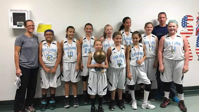 The Team Carolina 12 and under girls basketball team won the bronze division of the Surry Storm Fall Hoopfest tournament held over the weekend in Mount Airy.