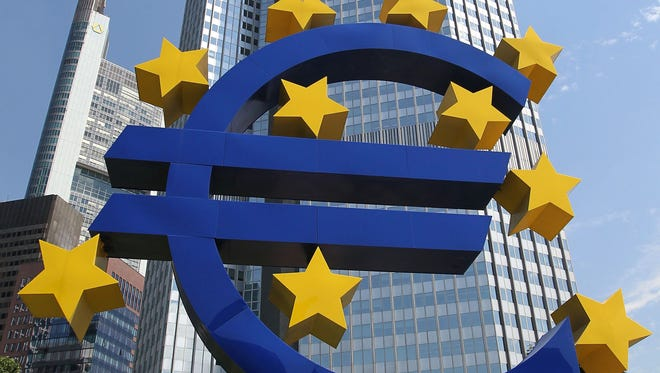 German artist Ottmar Hörl 's sculpture depicting the Euro logo is pictured in front of the former headquarter of the European Central Bank (ECB) in Frankfurt.