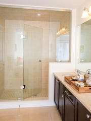 Frame-less glass shower stall in new bathroom