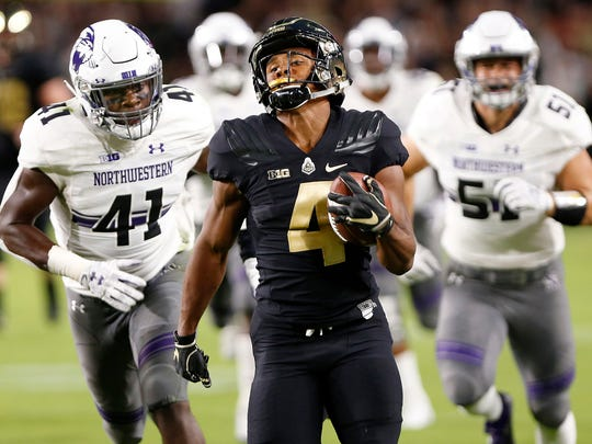 Purdue's Rondale Moore runs for a long touchdown against Northwestern in the first quarter of an NCAA college football game in West Lafayette, Ind, on Aug. 30, 2018.