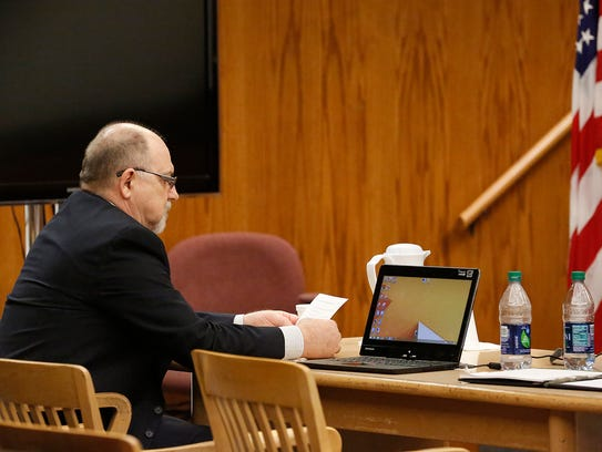 Dennis Brantner sits at the defense table while his