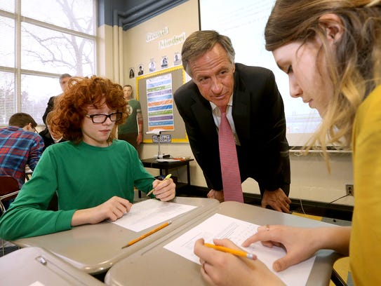 Tennessee Governor Bill Haslam center talks with Central