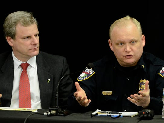 Interim Police Chief Troy Bankert, right, talks about