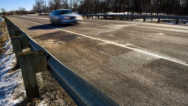Cars pass the site of a deadly crash on Minnesota Highway 23 near 11th Avenue Wednesday, Feb. 1, in Foley.