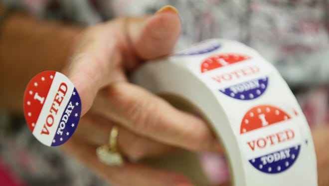 """I voted"" stickers are handed out in voter precincts."