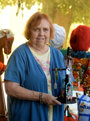 Vicki Brim holds some items available for sale in the Senior Opportunities Services craft shop at 401 S. Fourth St. in Richmond.
