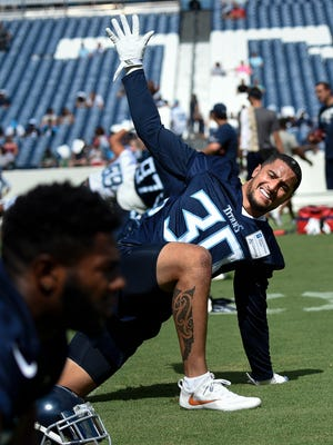 Titans safety Kenny Vaccaro (30) warms up during a training camp practice at Nissan Stadium Saturday, Aug. 4, 2018, in Nashville, Tenn.