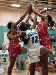 Sydney Eugene of Gulf Coast fights for a rebound against