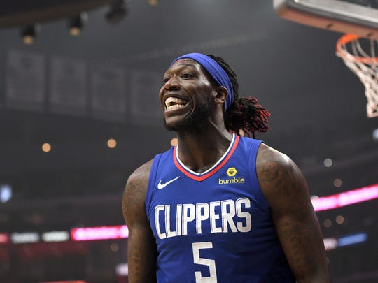 Los Angeles Clippers forward Montrezl Harrell talks with officials during an NBA basketball game against the Los Angeles Clippers, Sunday, April 1, 2018, in Los Angeles. (AP Photo/Michael Owen Baker)