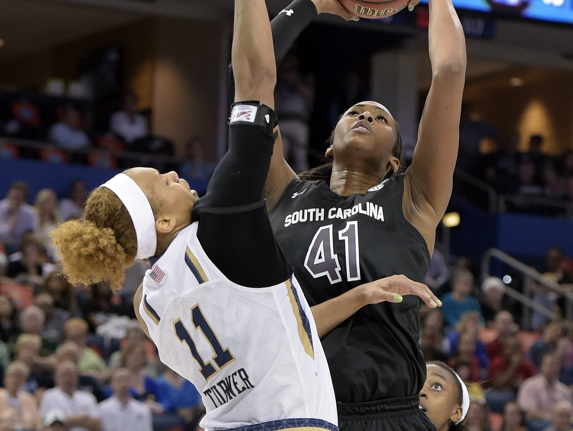 Alaina Coates, shown shooting over Notre Dame forward Brianna Turner during an NCAA Final Four tournament semifinal game in 2015, is headed for the WNBA - eventually.