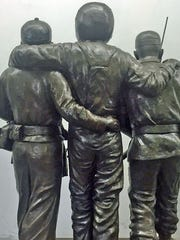 This life-sized sculpture of two Hmong soldiers holding up a downed American Pilot will top the granite base of the Hmong Vietnam War Veterans Memorial