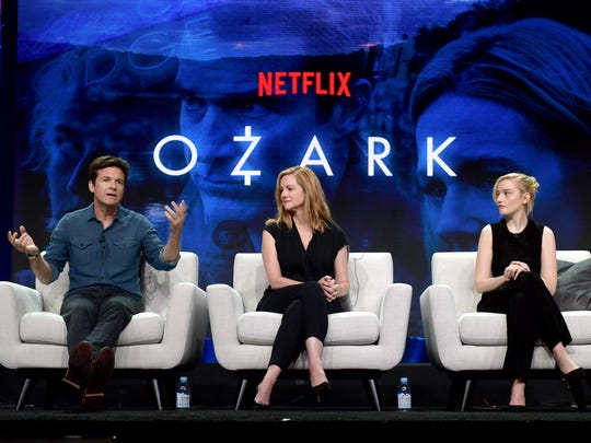 Jason Bateman, left, Laura Linney and Julia Garner