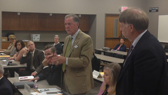 Madison County Mayor Jimmy Harris, left, and Sheriff John Mehr, right, stand up to talk about the Madison County Criminal Justice Complex during Monday's Sept. commission meeting.