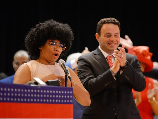Andre Sayegh who will be sworn in as Mayor of Paterson, applauds as We McDonald sings the National Anthem during the City of Paterson Inaugural Ceremony 2018 at the International High School in Paterson on 07/01/18.