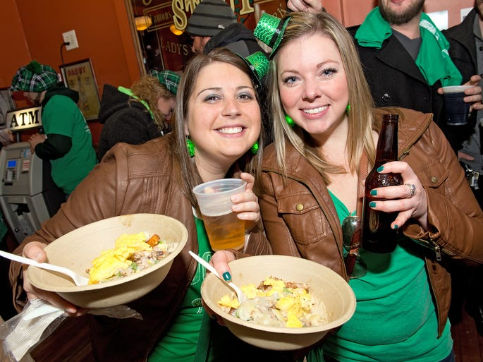 Molly Malone's Irish Pub in Covington celebrated St. Patrick's Day with Kegs & Eggs, live music and a lot of green beer.  Stacey Meyer of Union and Candra Wehmeyer of Burlington.