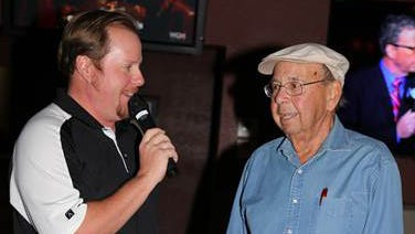 Al Ruskin of Peoria won third place in a wing sauce competition at the Half Moon Sports Grill in Phoenix. Here he's introduced by Mike Jack Bauer, a radio host on Fox Sports in Phoenix.