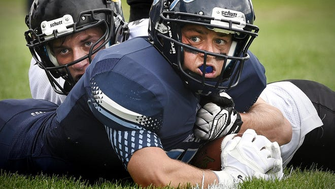 Hutchinson's Travis Gauer and Becker's Cody Gruenhaugen watch for the referee's call to confirm the Becker touchdown in the second half Saturday in Becker.