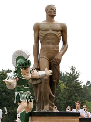 MSU's mascott, Sparty helps unveil the new Sparty Statue on the campus of Michigan State University, Aug. 25, 2005. Members of the MSU Marching Band play the fight song during the unveiling.