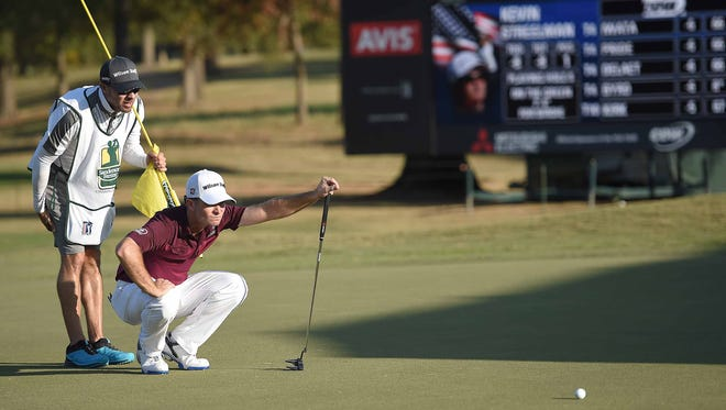 Kevin Streelman and his caddy line up the putt on the 8th green on during the first round of Sanderson Farms Championship at the Country Club of Jackson.