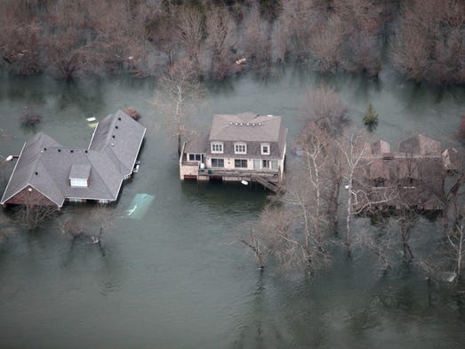 Floodwaters from Lake Taneycomo surrounded several