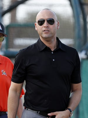 Miami Marlins chief executive officer Derek Jeter, right, walks with Marlins majority owner Bruce Sherman during spring training baseball practice Monday, Feb. 19.