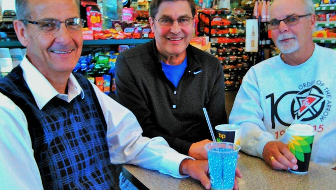 It's an era when grandparents relocate to retire near grandchildren.  These three North Liberty grandfathers talk about it during a new 9:30 a.m. weekly Wednesday coffee group at Liberty Doors.  From left are Richard Grugin, Bob Piper and Scott Swan.