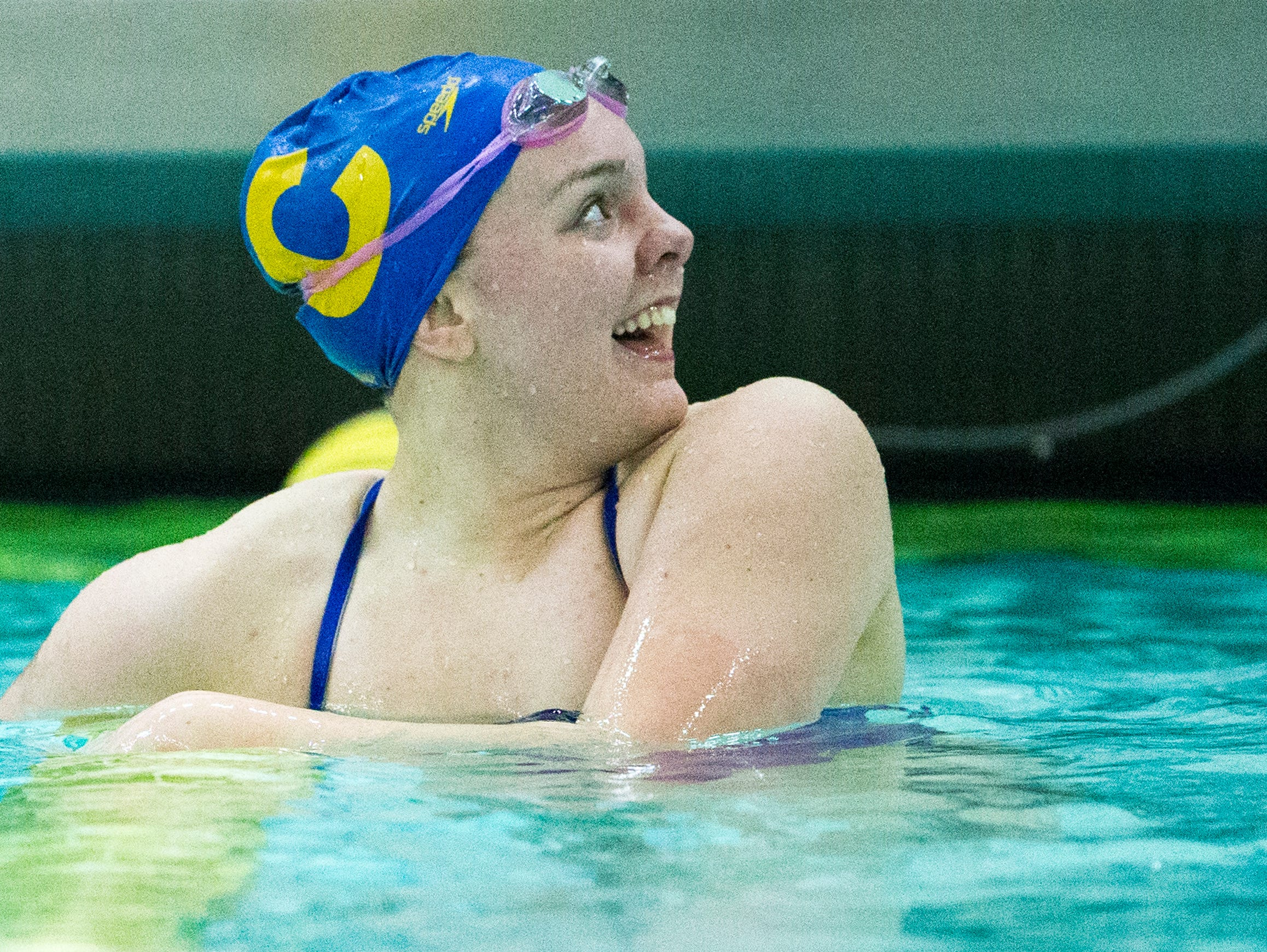 Carmel High School's Sammie Burchill reacts after winning the 200 yard IM at Saturday's girls swimming and diving sectional at Noblesville High School.
