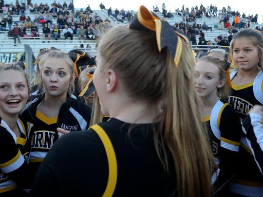 Enterprise High School cheerleaders get ready to take