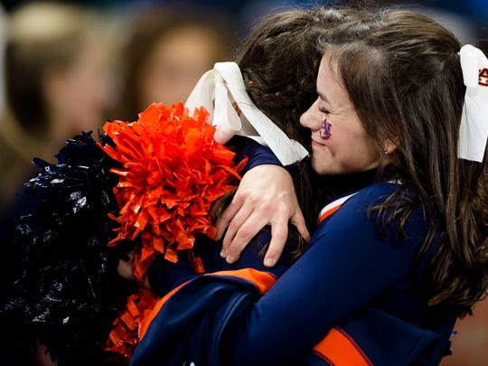 Auburn cheerleader embraces another after UCF defeated Auburn 34-27 in the Peach Bowl on Monday, Jan. 1, 2018, at Mercedes-Benz Stadium in Atlanta, Ga.
