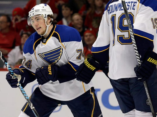 St. Louis Blues' T.J. Oshie (74) skates to the bench after scoring his goal during the first period in Game 6 of a first-round NHL hockey playoff series against the Chicago Blackhawks in Chicago, Sunday, April 27, 2014. (AP Photo/Nam Y. Huh)