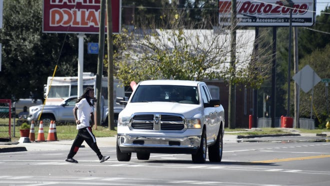 A pedestrian crosses Deans Bridge Road in Augusta, Ga., Monday afternoon October 19, 2020.