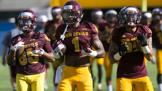 ASU wide receivers including N'Keal Harry (1) warm up during a spring football practice at Sun Devil Stadium in Tempe on Saturday, March 18, 2017.
