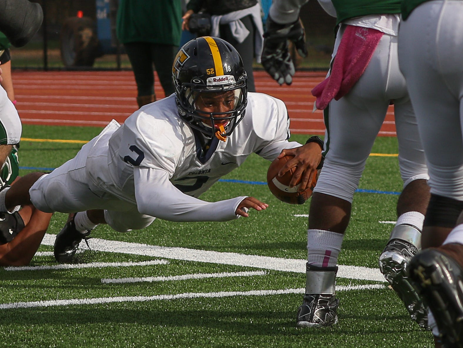 Colonia's Chase Barneys stretches out to try and score at St. Joe's in Metuchen on October 24, 2015 but was unable to reach the end zone.