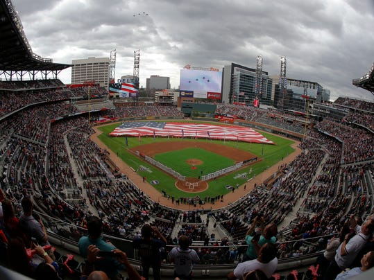 Philadelphia Phillies and Atlanta Braves line the infield as fighter jets fly overhead during the national anthem before an opening day baseball game at SunTrust Park, Thursday, March 29, 2018, in Atlanta. (AP Photo/John Bazemore)