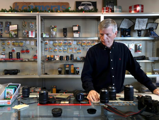 John Resch, owner of Valley Camera, goes through different