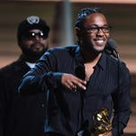 Kendrick Lamar receives the Grammy award for the Best Rap Album from N.W.A's Ice Cube.