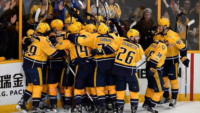 The Predators and fans celebrate the game-winning goal by left wing Kevin Fiala in overtime Monday to win the game 3-2 and take a 3-0 series edge against the Blackhawks.