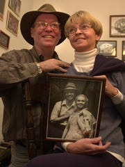 In a 2000 file photo, Peter J. Hill and wife Noel Irick hold a photo of themselves from the early 1980s.