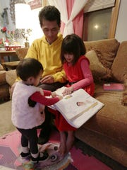 Wai Hinn Oo and his daughters, Cristina, 7, and Victoria,