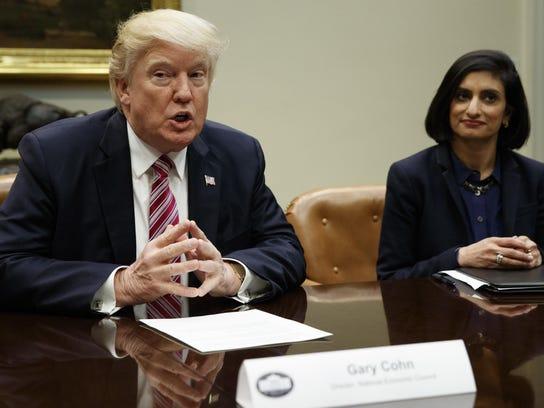 Seema Verma listens as President Trump speaks during