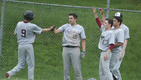 Albertus Magnus players celebrate after Mike Dunne