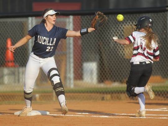Aucilla Christian first baseman Elizabeth Hightower reaches out to catch a throw just in time to beat Chiles' Abbie Townley.