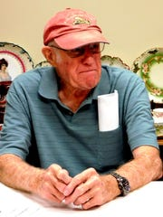 Conrad Shoup listens to details about Flag City Honor Flight during a veterans breakfast in Clyde.