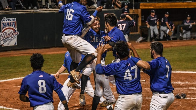 The Eagles celebrate a crucial victory at the NAIA World Series in Lewiston, Idaho, in June.