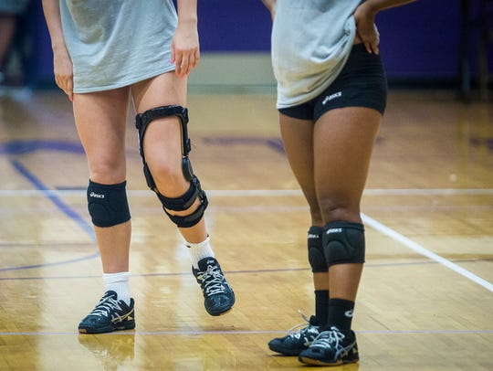 Central's Virginia Wilhoite wears a brace during their