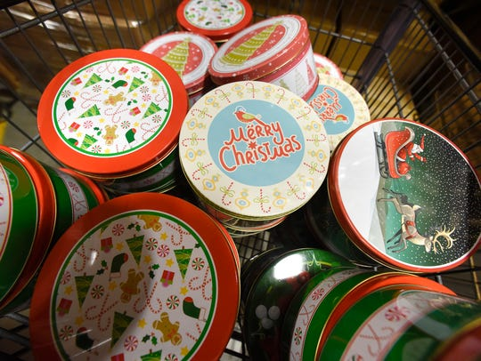 A collection of holiday-themed tins in the Crafts Direct