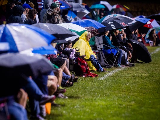 Fans brave rain and wind during the Yorktown versus