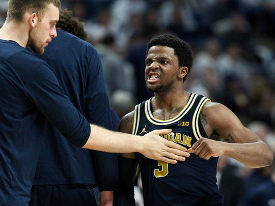 Michigan guard Zavier Simpson reacts during a timeout during the second half against Penn State on Feb. 21.