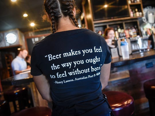 A server wears a themed t-shirt during training Monday,